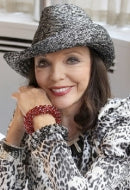 Actress Joan Collins in Fire Red and Starry Nigh