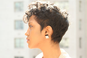 Faith Earrings in White + Black on model