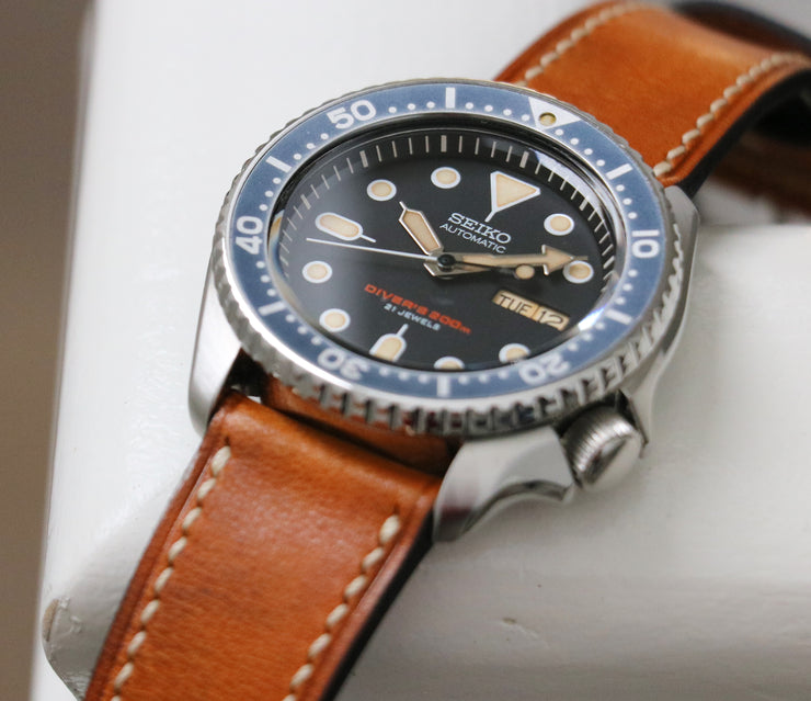 Seiko SKX007J on leather with faux patina