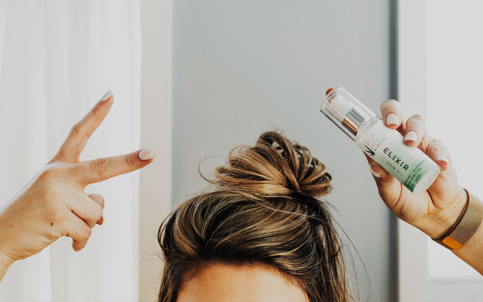 Hair Treatments & Hair Products, girl holding up a spray bottle over her head