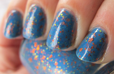 Raptor Girl Nail Polish - azure blue with orange and warm toned glitter - fanchromaticnails