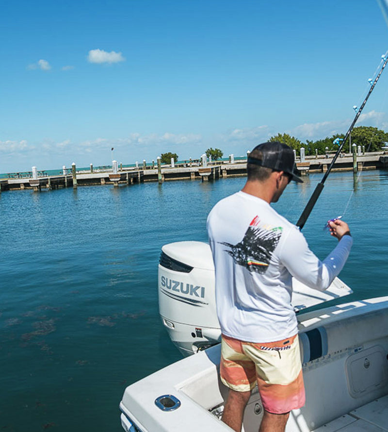 Salinity Gear performance SPF 50 sun protection dri-fit long sleeve fishing shirt. White shirt with screen printed rasta sailfish fish rubbing ( gyotaku ) design. The left sleeve has a rubbing of a ballyhoo and the front has a Salinity Gear logo.