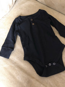 The Taylor Button Front Onesie In Black