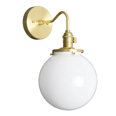 industrial style single light wall sconce with a clear glass globe