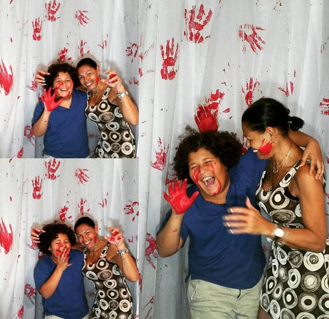 Halloween party photo booth bloody hand wall