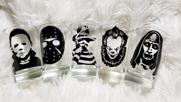 horror shot glasses on a white background
