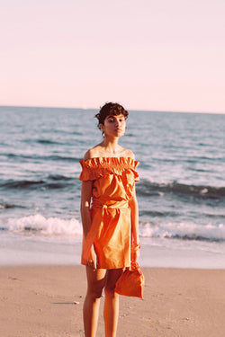 Orange ruffled off-shoulder dress