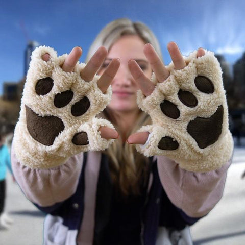 Unleash your inner animal with these awesome Animal Paw Gloves.  A cute and fun way to keep your hands warm during the long winter months. And what's best is you can still type away at your phone all day long.   Soft and very comfortable, the gloves are made from an easy wearing polyester fabric with the amount of stretch you want.  These are unisex one size fits all hands. Best of all they are Machine washable.