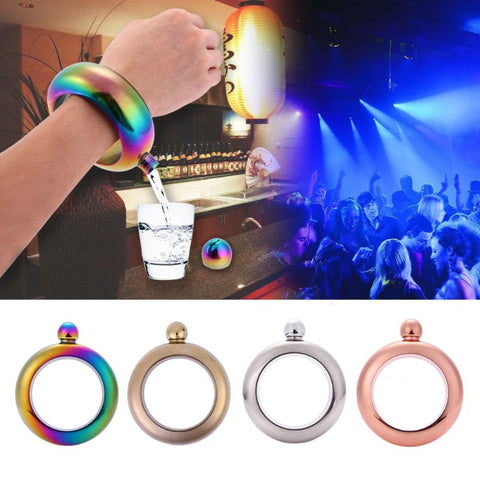 Ever been thirsty on the go, but had no liquid refreshment on you? The Flask Bracelet is the answer.  Simply top up the flask with your chosen beverage before you leave home, and keep sipping while you are on the go.  The Flask Bracelet is the perfect solution for that night out with friends.  Made of stainless steel. It holds 100ml of liquid and the inside diameter is 8cm.