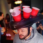 These hats are the ultimate party game. Put a new twist on the classic beer pong by putting it on your head!  Grab your most competitive drinking buddy and see who can really toss like a boss.  Contains 1 Hat, 6 Cups and 2 Balls.