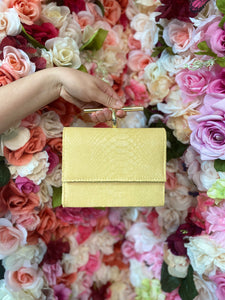 Light yellow snakeskin mini bag
