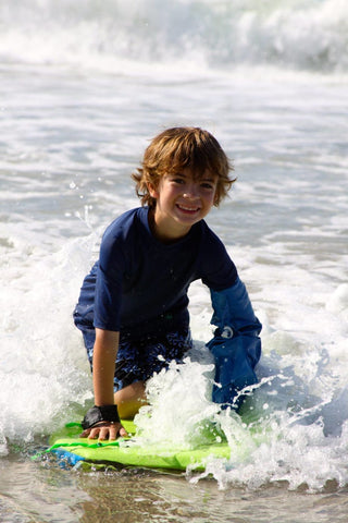 Kid in a cast surfing DryPRO Waterproof Cast Cover