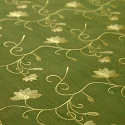 bright green and gold embroidered silk fabric