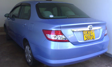 Light Blue Honda Aria Car for Rent