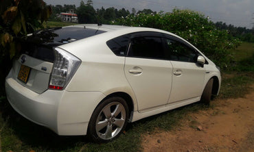 White Toyota Prius Hybrid Car for Rent