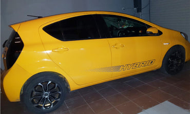 Yellow Toyota Aqua Hybrid Car for Rent