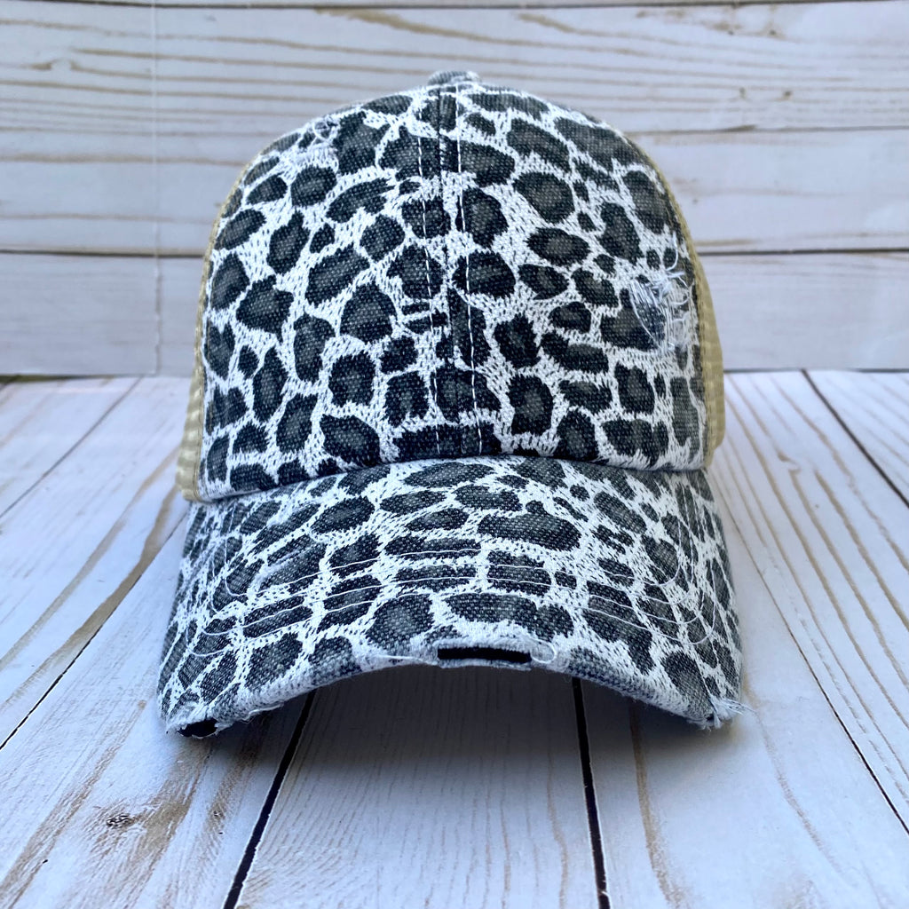 White and Black Animal Print Criss Cross Ponytail Hat
