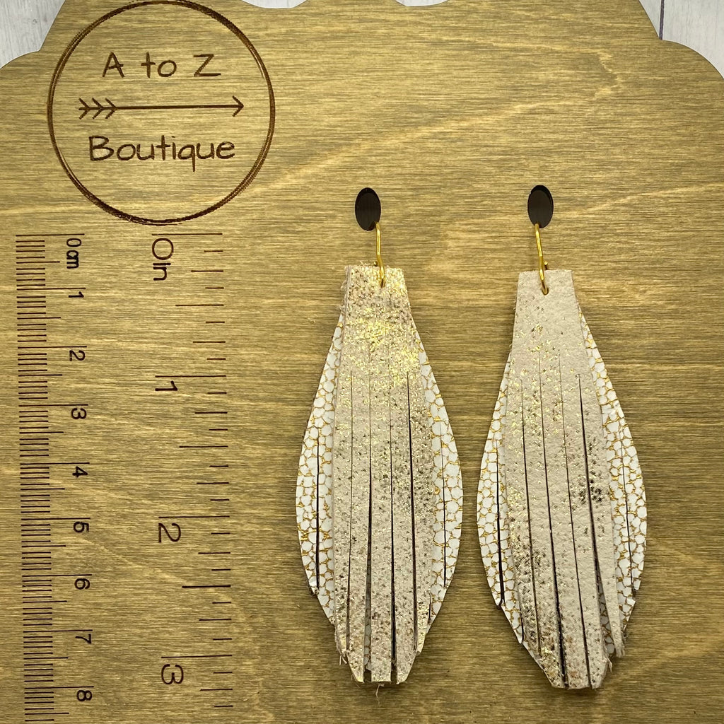 Gold and white leather leaf earrings