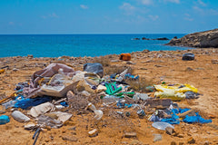Plastic waste on beach Happi Body Co