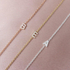 THEIA SIDEWAYS INITIAL NECKLACE