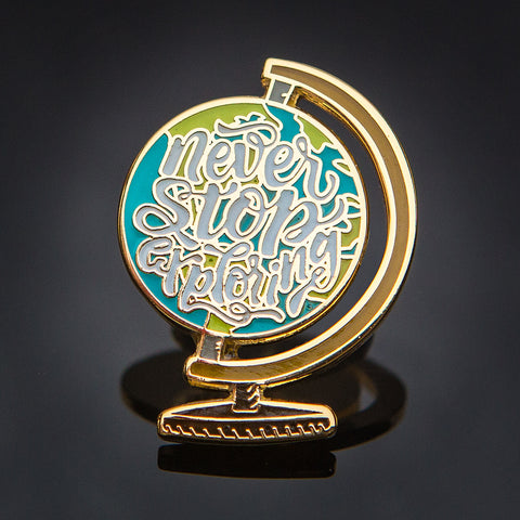 Never Stop Exploring Pin: Gold