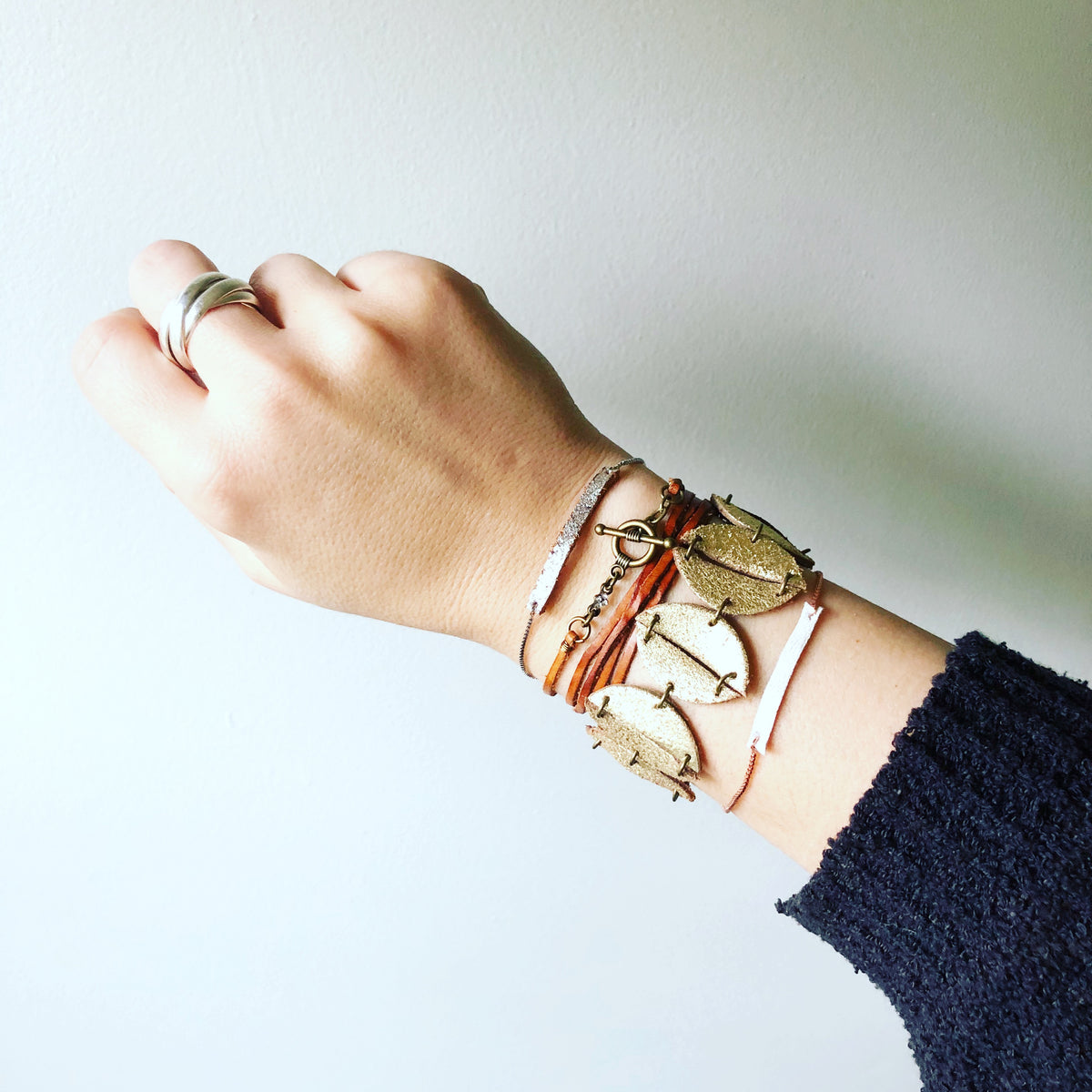 Arm party featuring a wrap, cuff, and two simple slider chains.