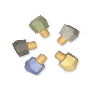 Concrete bottle stopper, polygon shape in yellow, blue, dark grey, green and light grey