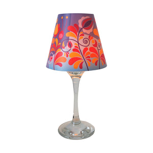 "Wine glass with ""lamp"" shade with typical hungarian stylised flower design in shades of purple, red, yellow and light blue."