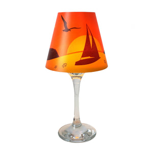 "Wine glass with ""lamp"" shade with boat at sunset illustration."