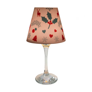"Wine glass with ""lamp"" shade with Christmas design on white background."