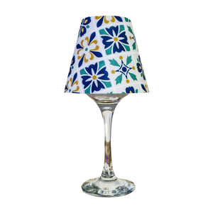 "Wine glass with ""lamp"" shade with typical Marrakech blue tile design on white background."