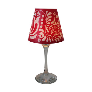 "Wine glass with red ""lamp"" shade with typical hungarian Matyo design."