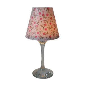 "Wine glass with ""lamp"" shade with small vintage roses pattern on white background."