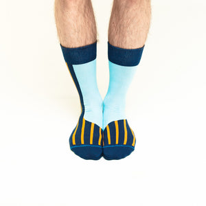 Nebouxii light blue socks with yellow and dark blue lines and accents