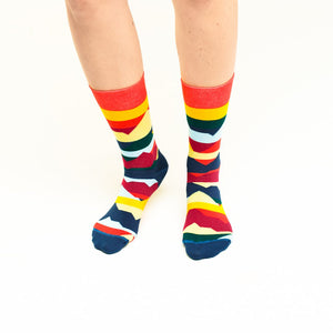 Nebouxii colourful socks with layers of yellow, red, green, dark and light blue, coral, orange