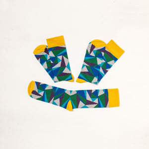 Soseta3 pair of socks with green triangles pattern. 3 socks in one pair, unfolded.