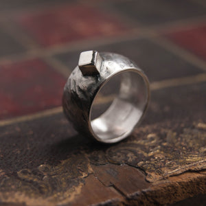 Domed silver ring with square nugget