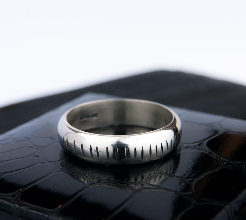 Mens carved wedding band
