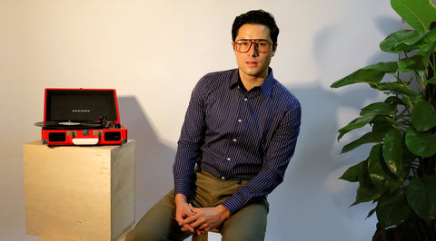 Model in photo studio wearing CYC navy checked shirt. Fabric by Getzner.