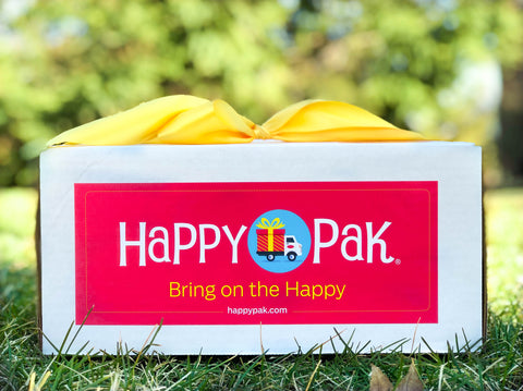 classic happy pak with yellow bow and pink label in grass