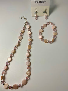 Short necklace, bracelet and earring set with tinted mother of pearl stations in pink.
