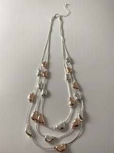 Short three-row necklace, with two-tone textured stations.