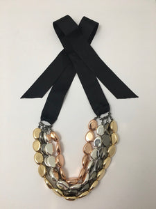 Versatile necklace, with four-row multi-tone beads on ribbon tie.