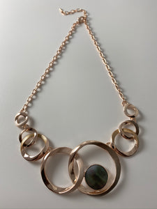 Short necklace, with rose gold interlinked circular stations and mother of pearl detail.