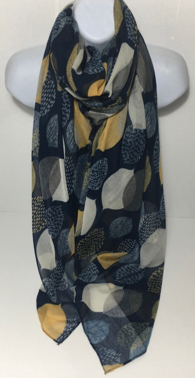 Navy, white and mustard scarf with leaf print.