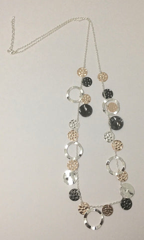 Long necklace, with battered metal discs, in rose gold, silver and pewter tone