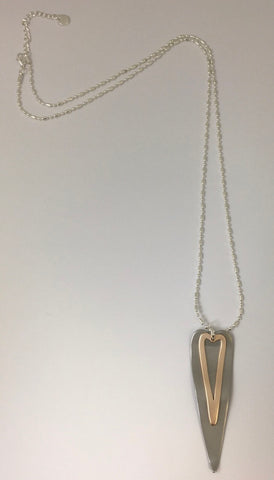 Long necklace, with beaded chain and a silver and rose heart on heart design.