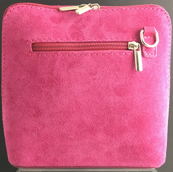 Suede cross-body bag in fuchsia