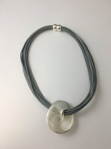 Short necklace, with silver tone and grey spiral, including a magnetic clasp.
