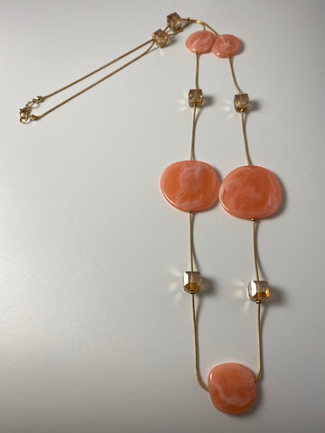 Long necklace, with coral circular stations and rondelle beads.